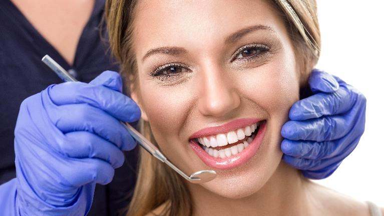 a woman smiles as she gets her teeth whitened | teeth whitening bondi junction